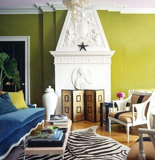 Domino Magazine - living rooms: fireplace, blue, velvet, sofa, yellow, velvet, pillows, green, walls, paint, color,  Green walls paint color,