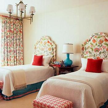 House Beautiful - girl's rooms - houndstooth bench, houndstooth ottoman, pink houndstooth bench, pink houndstooth ottoman, turquoise bed skirt, turquoise blue bed skirt, faux bamboo chandelier, turquoise lamp, floral headboards, shared girls room, shared kids room, floral curtains, floral drapes,