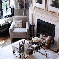 living rooms - corner chair living room, living room corner chair, gray chair, velvet chair, gray velvet chair, brass coffee table, antique brass coffee table, mirrored top coffee table, living room fireplace, marble fireplace surround, Cyprus Coffee Table,