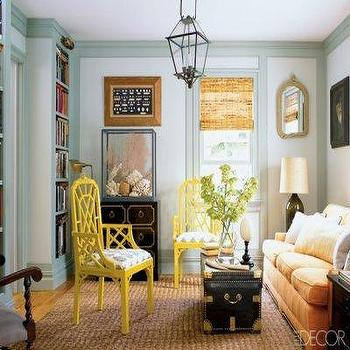 Elle Decor - living rooms - yellow chairs, lattice chairs, yellow lattice chair, trunk coffee table, black trunk, dorothy draper, dorothy draper chest, carriage lantern, rope mirror,