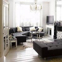 House to Home - living rooms - black, tufted, sofa, bench, cowhide, rug, crystal, chandelier, black, fireplace, sectional, sectional sofa, blue sectional, blue sectional sofa, tufted sectional, tufted sectional sofa, blue tufted sectional, blue tufted sectional sofa,