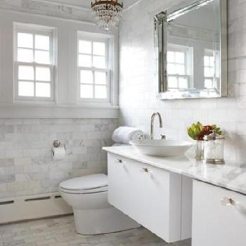 House & Home - bathrooms - calcutta gold marble, calcutta gold, calcutta gold marble subway tile, calcutta gold marble bathroom, calcutta gold marble subway tile bathroom, floating bathroom vanity, floating double vanity, bowl sink, marble staggered tiles, staggered marble tiles,