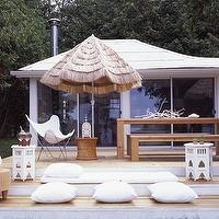 House & Home - decks/patios - patio umbrella, teak dining table, teak dining bench, outdoor pillows, outdoor cushions, Butterfly Chair,  Modern