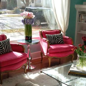 Nest Instinctual Interiors - living rooms - hot pink chair, bergere chair, hot pink bergere chair, pink bergere chair, turquoise walls, white sheepskin rug,