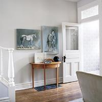 Style at Home - entrances/foyers - gray, walls, paint, color, farrow & ball, skimming stone, demilune, console, table, horse, art, jenn pratt, wood, floors, silver, metallic, wallpaper,