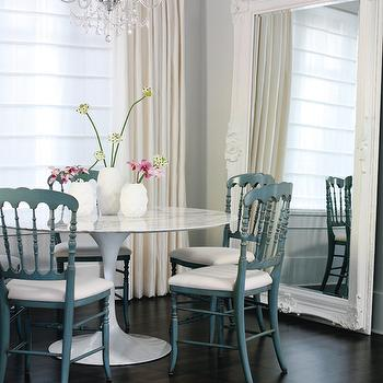 Style at Home - dining rooms - baroque floor mirror, white baroque mirror, white baroque floor mirror, dining room mirror, dining room floor mirror, saarinen dining table, turquoise dining chairs, turquoise blue dining chairs, painted dining chairs, light blue walls, light blue wall paint, Saarinen Table,