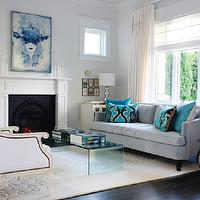Style at Home - living rooms - blue, velvet, sofa, turquoise, blue, pillows, acrylic, lucite, coffee table, fireplace, white, textured, rug, white, chairs, nailhead trim, white, drapes, silver, gourd, lamps, espresso, wood floors, blue art, white, blue, walls, paint, color, gray, blue, living room,