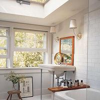 Elle Decor - bathrooms - white, subway, tiles, rustic, wood, stool, bench, sink, chrome, base, rustic, leaning, mirror, windows, skylight, bathroom,