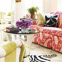 House Beautiful - living rooms - red, sofa, black, white, cowhide, rug, coffee, table, green, striped, chairs,  Eclectic living room - red sofa,