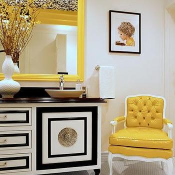 Storm Interiors - bathrooms: yellow chair, tufted chair, yellow tufted chair, yellow and black room, yellow and black foyer, yellow mirror, black and white cabinet, black and white credenza, hollywood regency credenza,