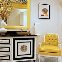 Storm Interiors - bathrooms - yellow, tufted, chair, yellow, beveled, mirror, overmount, sink, gourd, vase, black, white, vanity, yellow chair, tufted chair, yellow tufted chair,