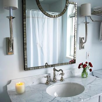 Teresa Meyer Interiors - bathrooms - blue walls, blue paint, blue paint color, blue bathroom walls, blue bathroom paint, blue bathroom paint color, white carrera marble, white carrera marble top, white carrera marble countertop, blue paint colors, blue bathroom colors, blue bathroom paint colors, vintage style faucet, , Ballard Designs D'orsay Mirror, White Carrara marble, French Deco Horn Sconce,