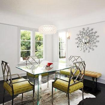 Form Interior Design - dining rooms - faux bamboo chairs, metal bamboo chairs, white cowhide rug, glass top dining table, glass topped dining table, yellow bench, yellow tufted bench, Jupiter Chandelier,