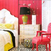 House & Garden - bedrooms - faux bamboo chest, hot pink chair, hot pink walls, yellow and black bedding, black and white rug, Vintage faux Bamboo Chest,