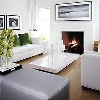 Style at Home - living rooms - gray, leather, ottoman, white, sofa, apple, green velvet, pillows, modern, fireplace, white, glossy, lacquer, modern, coffee table, black, white, photography, art, white, drapes, chestnut, stained, wood, oak, floors, living room,