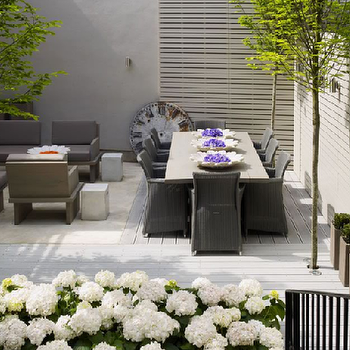 Kelly Hoppen Interiors - decks/patios - outdoor furniture, outdoor dining furniture,  Bountiful hydrangeas! Modern outdoor furniture!