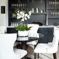 Kelly Hoppen Interiors - dining rooms - white, tufted, baker, dining, chairs, nailhead, trim, round, glass, top, wood, base, dining, table, black, built-ins, cabinets, shelves, dining room, dining chairs, tufted dining chair, nailhead dining chairs, nailhead tufted dining chair, white dining chair, white tufted dining chair, nailhead trim dining chairs,