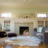 living rooms - fireplace, bookshelves, tile, flokati, rug, gray, modern, sofa, purple, velvet, modern, chair, ottoman, directoire, table, built-ins, bookshelves,