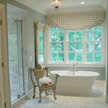 Gray and white bathroom with seamless glass shower partition framing a - Gray Marble Countertops Transitional Bathroom At