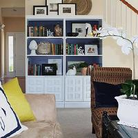 Emily A. Clark - living rooms - bookcases, bookshelves, living room, monogrammed pillows, navy, white, Benjamin Moore Stunning, kilim beige, painted back of shelves, painted back of bookshelf,