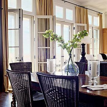 Coastal Living - dining rooms - french doors, wall of french doors, transom windows, wall of transom windows, french doors and transom windows, gold curtains, gold drapes, black dining chairs, wicker dining chairs, black wicker dining chairs, dining room french doors,