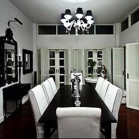 Monochrome Inc Interior Design - dining rooms - black, white, gilt, chandelier, white, slip covers, black, piping, parquetry, floor, plantation, shutters,