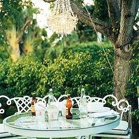 Domino Magazine - gardens - outdoor space, alfresco dining,  Whimsical outdoor space. gorgeous crystal chandelier and outdoor table and chairs.