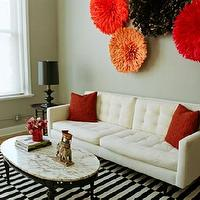 Scout Designs NYC - living rooms - black, white, red, orange, sofa, lamp, marble, ikea rug, ikea stockholm rug, stockholm rug, stockholm rand rug, Crate & Barrel Petrie Sofa, Ikea Stockholm Rand Rug, JuJu Hat,
