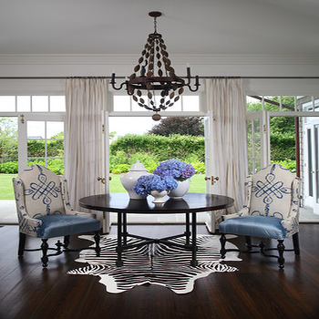 dining rooms - zebra rug, black and white zebra rug, white and black zebra rug, round dining table, black dining table, white and bleu chairs, wood chandelier, beaded wood chandelier, wood beaded chandelier, french doors, transom windows, french doors and transom windows, Zebra Cowhide Rug,