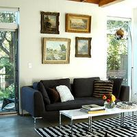 Design Sponge - living rooms - ikea rug, black and white rug, black and white striped rug, striped rug, stockholm rand rug, black sofa, black tufted sofa, low sofa, low black sofa, nesting coffee tables, concrete floors, concrete living room floors, IKEA STOCKHOLM RAND,