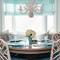 Waterleaf Interiors - dining rooms - turquoise dining room, turquoise blue dining room, turquoise roman shades, linen roman shades, turquoise linen shades, round dining table, gray dining table, bamboo chairs, white bamboo chairs, faux bamboo chairs, turquoise place mats, dining banquette, built in dining banquette, turquoise seat cushions, turquoise blue seat cushions,