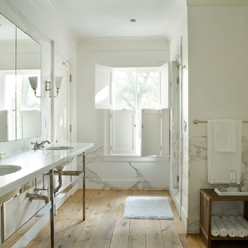 Eric Roth Photo - bathrooms - bathroom shutters, shutters in bathroom, marble double washstand, rustic wood floors, plank floors, plank wood floors, white marble backsplash,