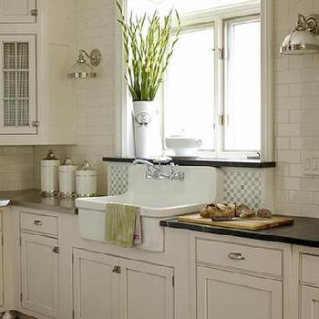 House & Home - kitchens - ceiling height tile, ceiling height subway tiles, ceiling height kitchen tiles,  Lovely white modern farmhouse kitchen