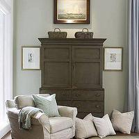 Phoebe Howard - bedrooms - armoire, distressed armoire,  Beautiful gray sitting area in bedroom design with oatmeal slip-covered accent chair