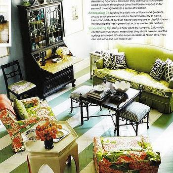 Domino Magazine - living rooms - painted floors, striped floors, painted striped floors, striped painted floors, white and green floor, herringbone floor, green sofa, nesting coffee tables, moroccan accent table, floral chairs, floral print chairs, black secretary desk,