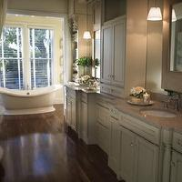 bathrooms - wood floor, claw foot tub, pendants, marble counter, double sink, white cabinet, crystal knobs,  tradition bathroom  Tub, ivory cabinets,