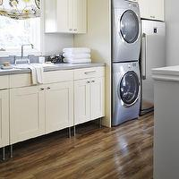 House & Home - laundry/mud rooms - ivory, cream, cabinets, gray, countertop, gray, walls, paint, color, white, yellow, gray, floral, roman shade, wood, floors, laundry room, cream cabinets, cream laundry room cabinets, cream shaker cabinets, cream shaker laundry room cabinets,