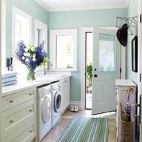 House & Home - laundry/mud rooms - blue, green, striped, rug, schoolhouse, pendant, light, ivory, cabinets, drawers, white, countertop, blue, walls, paint, color, wicker, umbrella, stand, blue, green, laundry room, mudroom, mudroom design, mudroom cabinets, mudroom laundry room, laundry room mudroom, blue mudroom, white and blue mudroom,