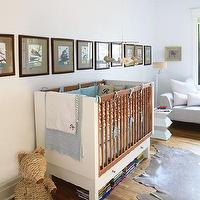 House & Home - nurseries - two tone crib, two tone nursery crib, art over crib, cowhide rug,  David Bagosy - Fantastic boy's nursery design with