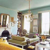 Domino Magazine - living rooms - domino, living room, green, tufted, bench, blue, walls, paint, color, green, drapes, fireplace, chandelier, eclectic, chic,