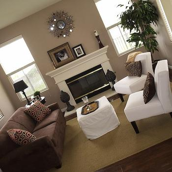 living rooms - Brown sofa, white chairs, taupe walls, white, mirror, fireplace, taupe paint, taupe paint colors, taupe paint color, taupe walls,