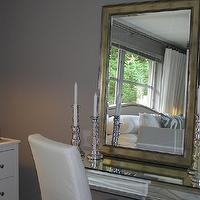 bedrooms - Candles, mirror, parsons chair,  Bedroom  Vintage mirror, vanity, candlesticks and soft gray walls paint color.