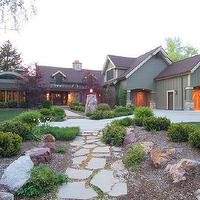 home exteriors - green, stone walk way, shrubs,  Great home. Love the walk way.  Stone walkway path and home exterior.