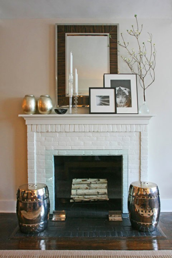 Ron Marvin - living rooms - West Elm Silver Leaf Canisters, Fulton Zebrawood Mirror, zebrawood mirror, fireplace mirror, brick fireplace, white brick fireplace, silver leaf canisters, silver stools, silver garden stools,