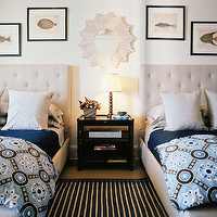 Ivory & blue coastal boy's bedroom design with ivory cream tufted headboards beds, ...