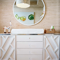 Modern nursery design with white modern changing table dresser, cushion, round ...