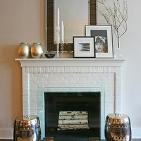 Ron Marvin - living rooms - zebrawood mirror, fireplace mirror, brick fireplace, white brick fireplace, silver leaf canisters, silver stools, silver garden stools, West Elm Silver Leaf Canisters, Fulton Zebrawood Mirror,