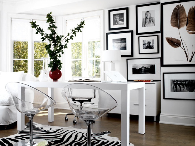 LLoyd Ralphs Design - dens/libraries/offices - West Elm Parson Desk, Zebra Cowhide Rug, lucite chairs, lucite chair, white desk, parsons desk, white parsons desk, zebra cowhide rug, black and white office, shared desk,