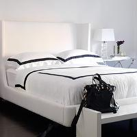 Ferreira Design - bedrooms - white, modern, wingback, headboard, bed, white, hotel, bedding, navy blue, ribbon, trim, modern, white, bench, glass, block, lamp, silver table, nightstand, chic, bedroom, white headboard, wingback headboard, white wingback headboard,