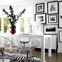 LLoyd Ralphs Design - dens/libraries/offices - lucite chairs, lucite chair, white desk, parsons desk, white parsons desk, zebra cowhide rug, black and white office, shared desk, West Elm Parson Desk, Zebra Cowhide Rug,